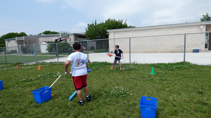 students playing water lacrosse